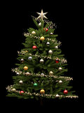 Decorated Christmas Tree Isolated on Black Background Royalty Free Stock Image