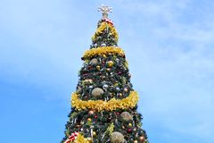 Decorated Christmas Tree on lightblue cloudy background in Lake Buena Vista area. Orlando, Florida. November 12 , 2018 . Decorated Christmas Tree on lightblue stock photos