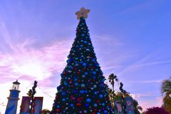 Decorated Christmas Tree and Lighthouse on beautiful background in International Drive area. Orlando, Florida. November 17, 2018. Decorated Christmas Tree and stock image