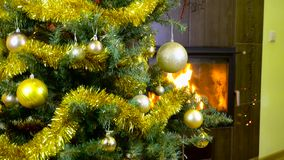 Decorated christmas tree with lights in front of fireplace. Christmas tree with decorations and lights in front of fireplace stock footage
