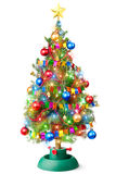 Decorated Christmas tree with luminous garland. Stands on a white Stock Photos