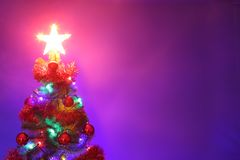 Decorated Christmas tree.Merry Christmas and happy new year greeting background with copy-space stock photo