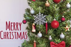 Decorated Christmas Tree with Merry Christmas Text. Decorated Christmas Tree with Merry Christmas Sign.Christmas Card Stock Photo
