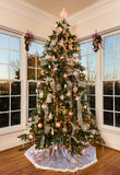 Decorated christmas tree in modern family room Royalty Free Stock Images