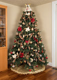 Decorated christmas tree in modern living room Royalty Free Stock Images