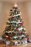 Decorated christmas tree in modern living room Royalty Free Stock Photos