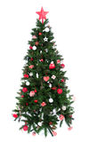 Decorated Christmas tree with patchwork ornament red star. Hat balls and small presents for new year isolated on white background Stock Photos