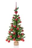Decorated Christmas tree with peak balls over a white background Royalty Free Stock Photos