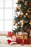 Decorated Christmas tree and presents. At home Royalty Free Stock Photos