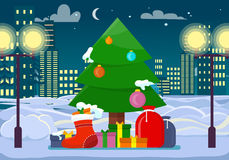Decorated Christmas Tree with Presents Outdoors Stock Photo