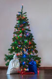 Decorated Christmas tree with presents under it Royalty Free Stock Image