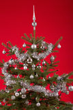 Decorated christmas tree on red background Stock Photo