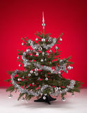 Decorated christmas tree on red background Royalty Free Stock Photos