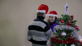 Decorated Christmas tree with romantic couple in background stock footage