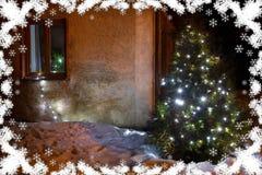 Illuminated x-mas tree lighting in winter garden stock image