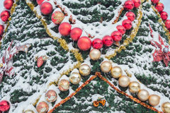 Decorated Christmas tree in the snow outside Royalty Free Stock Photo