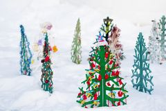 Decorated Christmas tree in a snowy park Royalty Free Stock Photos