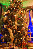 Decorated christmas tree in storefront window Royalty Free Stock Photography