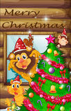 A decorated christmas tree surrounded with animals Royalty Free Stock Images