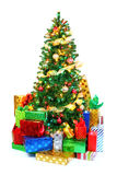 Decorated Christmas tree surrounded by colorful presents Stock Photography
