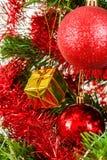 Decorated christmas tree on white background. Detail of decorated christmas tree with red balls Royalty Free Stock Image