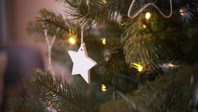 Decorated christmas tree. Wood star stock video