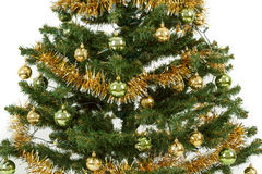 Decorated christmas tree with yellow and green balls Stock Photography