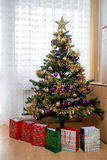 Decorated christmas tree with yellow and violet balls Stock Photo