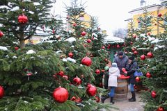 Decorated christmas trees at the Christmas market of Hellbrunn Palace. Salzburg, Austria. Salzburg, Austria - December 3, 2017: Decorated christmas trees and royalty free stock photography