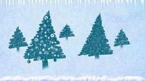 Decorated Christmas trees in the snow with snowflakes falling and icicles stock video