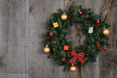 Decorated christmas wreath on barn board. Closeup Decorated christmas wreath on barn board royalty free stock image