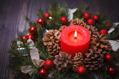 Decorated Christmas wreath with a candle close-up Royalty Free Stock Image