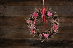 Decorated Christmas Wreath Red White Cloth Hearts Old Rustic Bac Stock Images