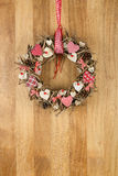 Decorated Christmas Wreath Red White Cloth Hearts on Sapele Wood Stock Photo