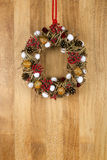 Decorated Christmas Wreath Walnuts and Pine Cones on Sapele Wood Royalty Free Stock Photos
