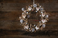 Decorated Christmas Wreath White Birch Hearts  and Pine Cones Ol. Decorated christmas wreath with white birch hearts brown twigs and pine cones on old wooden Stock Photography