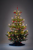 Decorated christmastree. Classic decorated christmastree on neutral grey background Royalty Free Stock Photos