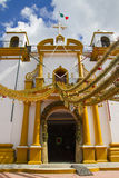 Decorated church in Mexico. Church decorated with gold tinsel to celebrate Christmas in San Cristobal de las Casas, Mexico Royalty Free Stock Photos