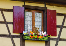 Decorated classic alsacien windows in old house Stock Photos