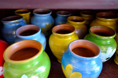 Decorated clay pots in the shelf Royalty Free Stock Photography