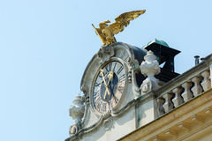 Decorated clock and golden eagle on top of Schönbrunn palace Stock Image
