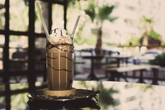 Iced coffee with cream in tall glass cup. royalty free stock image