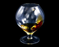 Decorated cognac glass, filled with some alcohol, Royalty Free Stock Photos