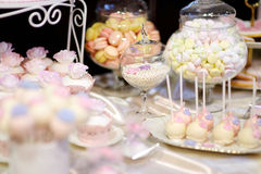 Decorated colorful candies on a white table Stock Images