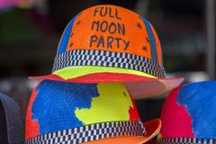 Decorated colorful hats sold on the beach before of the Full moon party on the island of Koh Phangan, Thailand Royalty Free Stock Photos