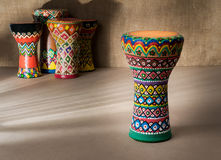 Decorated colorful pottery goblet drum on background of goblet d Stock Photos