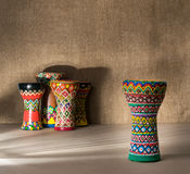Decorated colorful pottery goblet drum on background of goblet drums Stock Photos