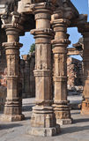 Decorated Columns in Qutub Courtyard, Delhi, India. The Qutub complex included a mosque whose structure included covered spaces supported by decorated stone Royalty Free Stock Image
