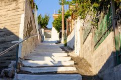 City street as a narrow passage with colored stairs Stock Photo