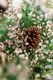 Decorated Cone with Flowers and Green Grass Stock Photo